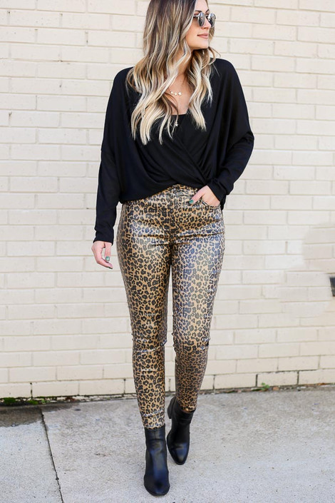 Model wearing the Leopard Coated Mid-Rise Skinny Jeans