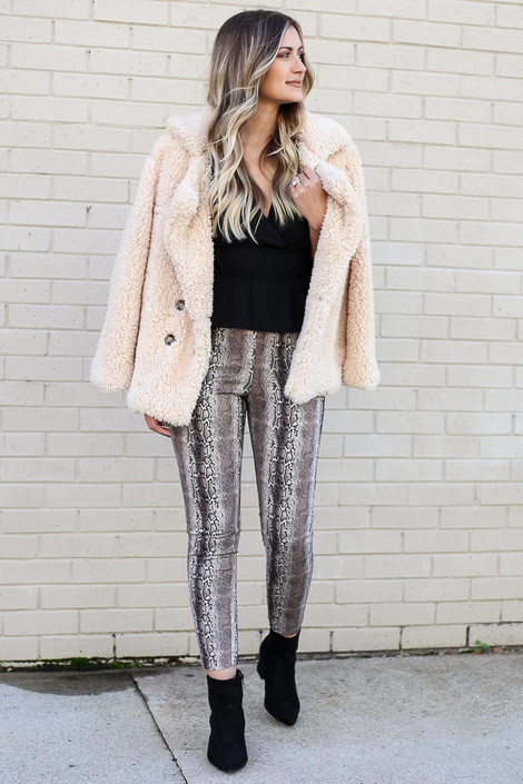 Model wearing the Snakeskin Microsuede Pants from Dress Up with Sherpa Teddy Jacket and Black Blouse