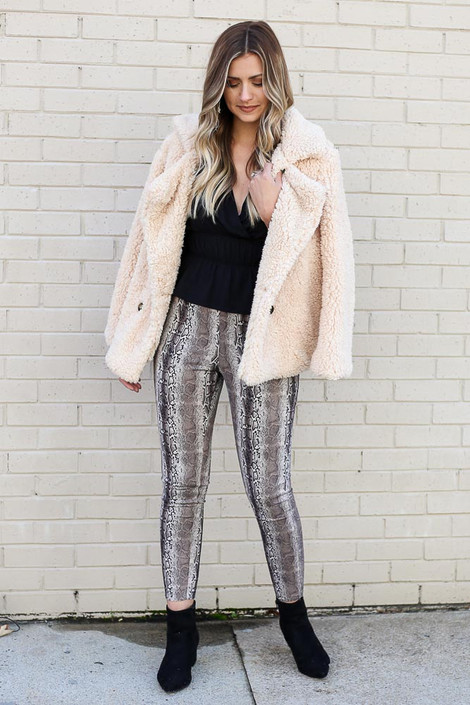Model wearing the Snakeskin Microsuede Pants from Dress Up with Sherpa Teddy Jacket and Black Blouse Front View