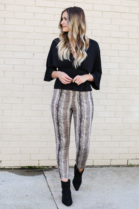 Model wearing the Snakeskin Microsuede Pants from Dress Up with Black Blouse and ankle booties from Dress Up