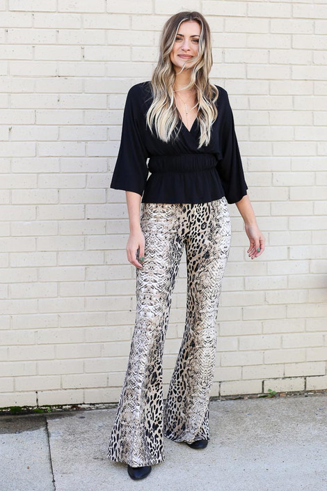 Model wearing the Ivy Animal Print Flare Pants