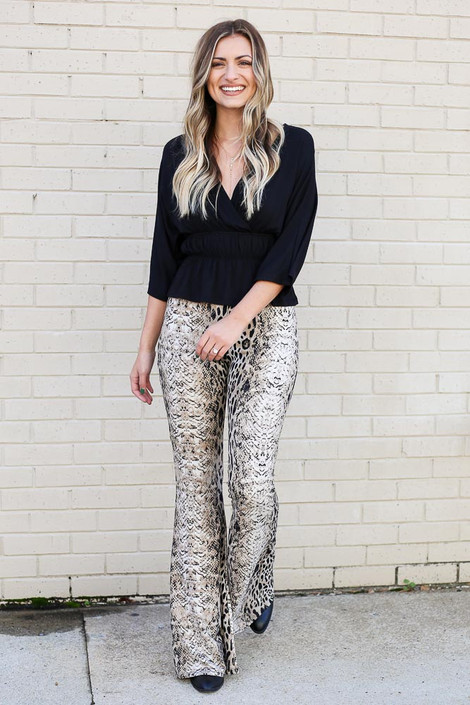 Model wearing the Ivy Animal Print Flare Pants from Dress Up
