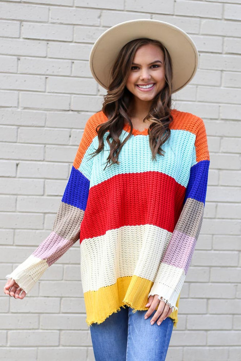 Model wearing the Multi Color Block Oversized Sweater with high rise jeans from Dress Up Front View