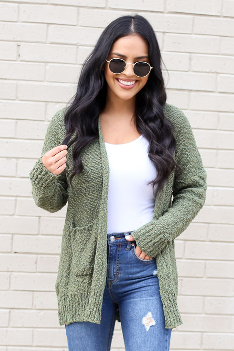 Model of Dress Up wearing the Popcorn Knit Cardigan in Olive with distressed jeans and tank top Front View