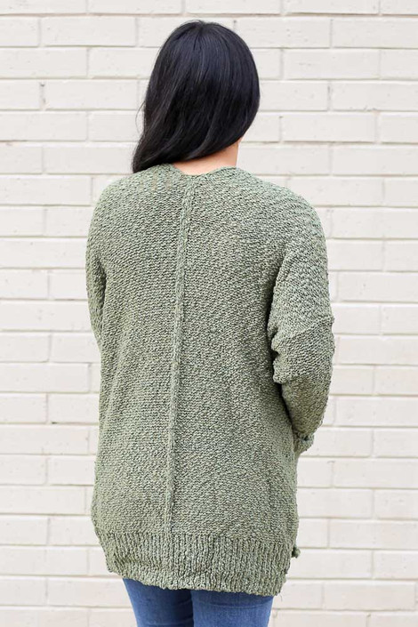 Model wearing the Popcorn Knit Cardigan in Olive Back View