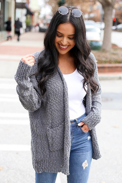 Model of Dress Up wearing the Popcorn Knit Cardigan with distressed jeans and tank top Front View