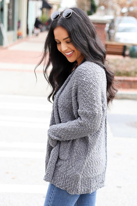 Model from Dress Up wearing the Popcorn Knit Cardigan in Charcoal Side View