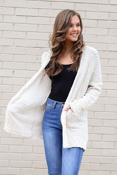 Model of Dress Up wearing the Popcorn Knit Cardigan in Ivory with medium wash jeans and tank top Front View