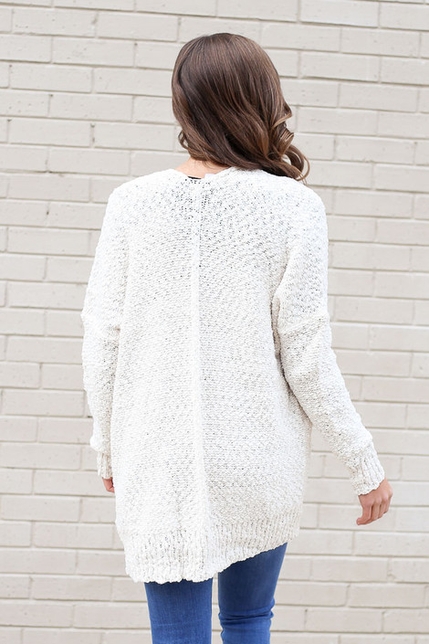 Model wearing the Popcorn Knit Cardigan in Ivory Back View