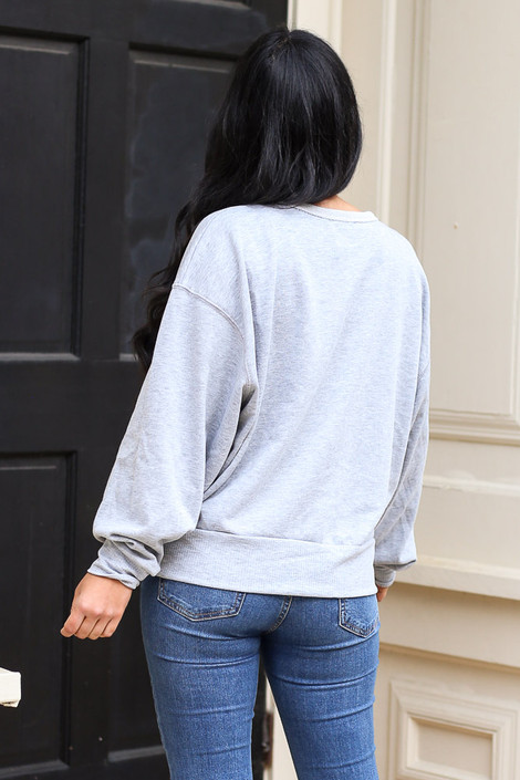 Model wearing the French Terry Oversized Pullover in Grey Back View from Dress Up