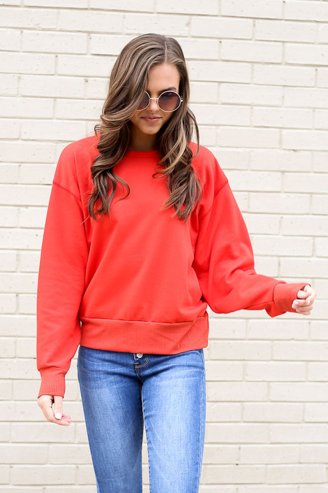 Model wearing the French Terry Oversized Pullover in Red Front View