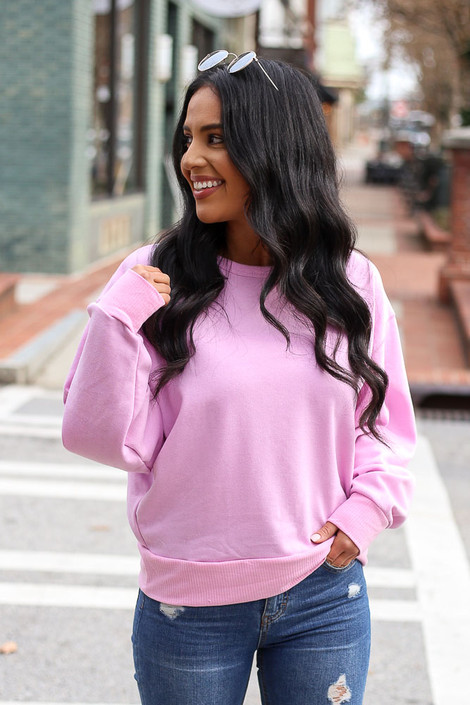Model wearing the French Terry Oversized Pullover in Lilac with dark wash jeans Front View