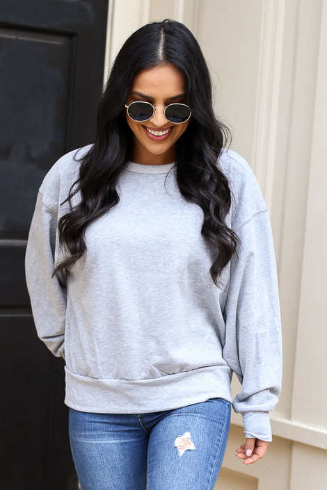 Model wearing the French Terry Oversized Pullover in Grey with distressed jeans Front View from Dress Up