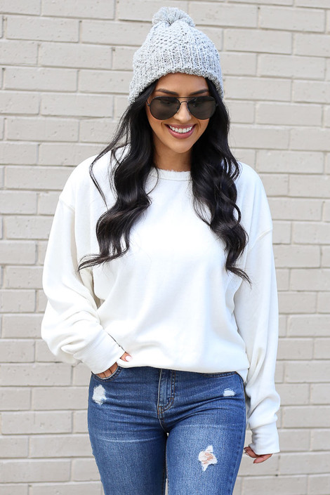 Model wearing the White Fuzzy Knit Pullover with pom pom beanie Front View