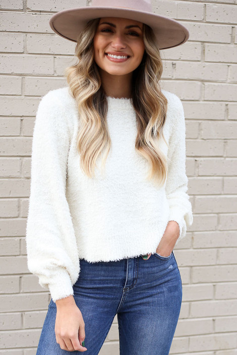 White - Model wearing the Balloon Sleeve Fuzzy Knit Sweater in White