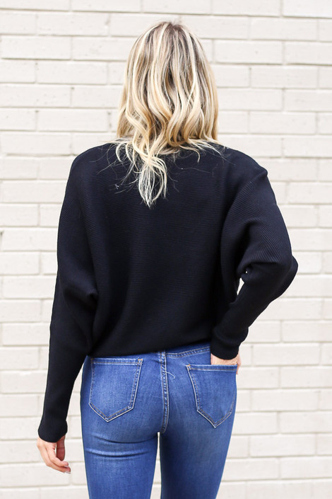 Model from Dress Up wearing the Ribbed Drop Sleeve Sweater in Black Back View