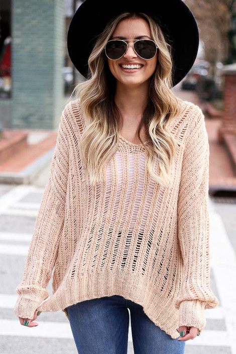 Model wearing the Blush Loose Ribbed Knit Sweater from Dress Up with wide brim hat and high rise jeans Close Up