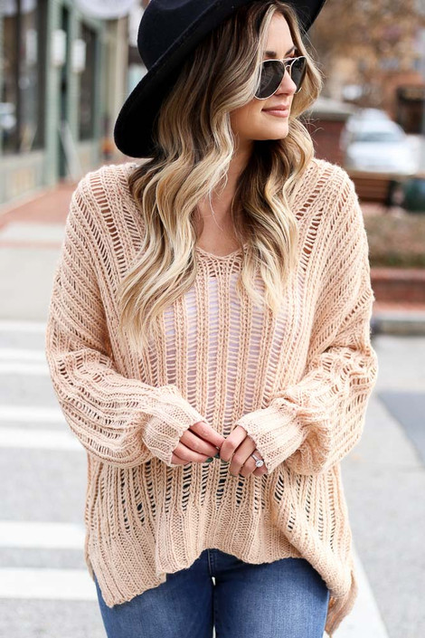 Model wearing the Blush Loose Ribbed Knit Sweater from Dress Up with wide brim hat and high rise jeans Front View