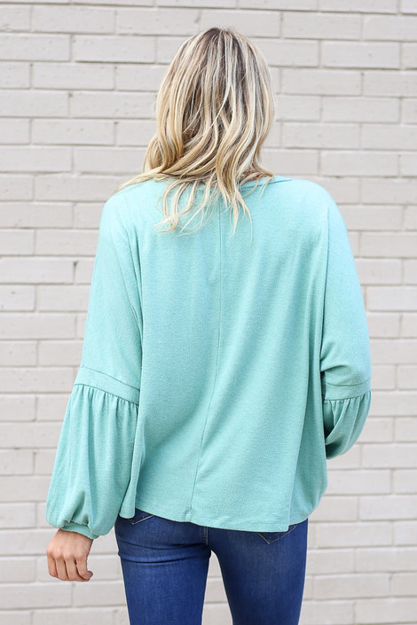 Model wearing the Oversized Brushed Knit Sweater in Sage from Dress Up Back View
