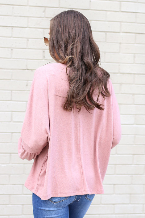 Model wearing the Oversized Brushed Knit Sweater in Blush from Dress Up Back View