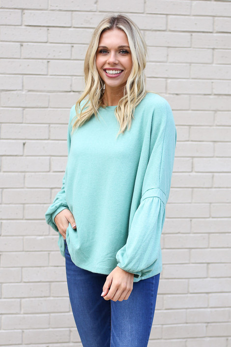 Model wearing the Oversized Brushed Knit Sweater in Sage from Dress Up Front View