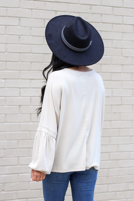 Model wearing the Oversized Brushed Knit Sweater in Taupe from Dress Up Back View