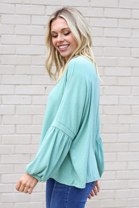Model wearing the Oversized Brushed Knit Sweater in Sage from Dress Up Side View