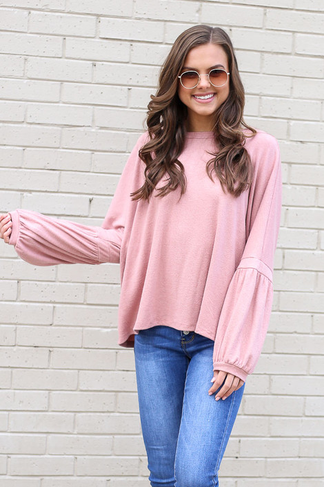 Model wearing the Oversized Brushed Knit Sweater in Blush with high rise jeans from Dress Up Front View