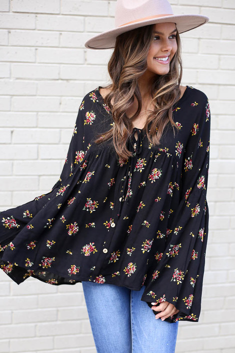 Black - Model from Dress Up wearing the Black Bell Sleeve Floral Babydoll Blouse with light wash jeans and wide brim hat