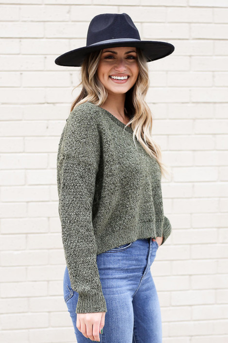 Model wearing the Cropped Chenille Sweater in Olive from Dress Up Side View
