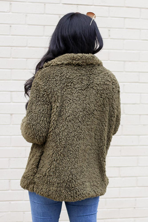 Model wearing the Sherpa Jacket from Dress Up in Olive Back View