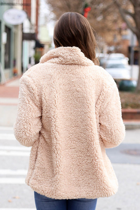Model wearing the Sherpa Jacket from Dress Up in Ivory Back View