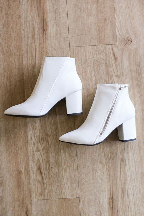 Flat lay of the Block Heel Ankle Booties from Dress Up
