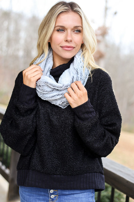 Model from Dress Up wearing the Faux Fur Infinity Scarf in Black with black sweater and high rise jeans Front View