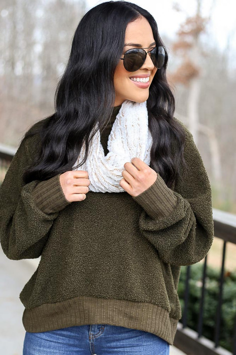 Model wearing the Faux Fur Infinity Scarf in Ivory with olive pullover from Dress Up Front View