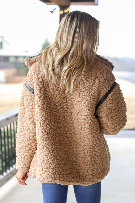 Model wearing the Shaggy Teddy Jacket with medium wash jeans Back View