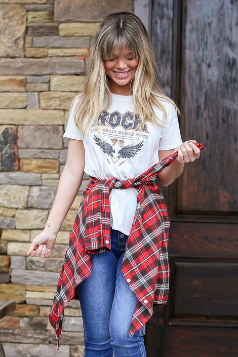 Model wearing the World Tour Graphic Tee with a flannel