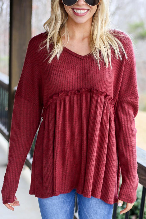 Model wearing the Waffle Knit Babydoll Hoodie in Burgundy from Dress Up Close Up View