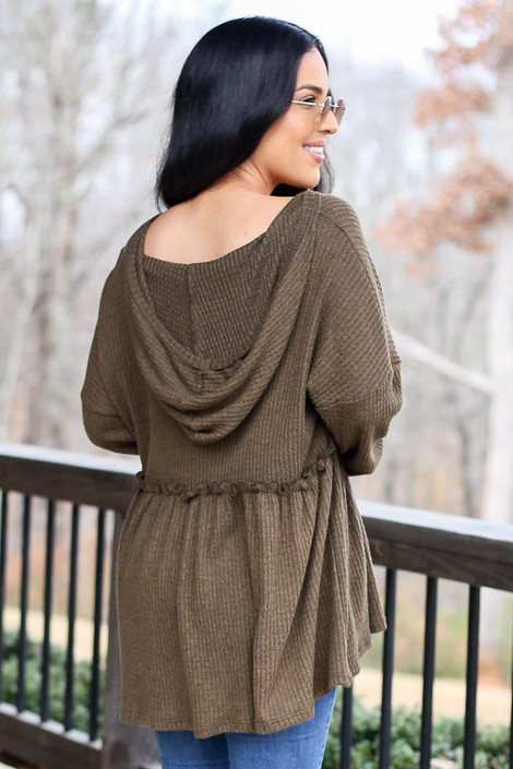 Model wearing the Waffle Knit Babydoll Hoodie in Olive from Dress Up Back View