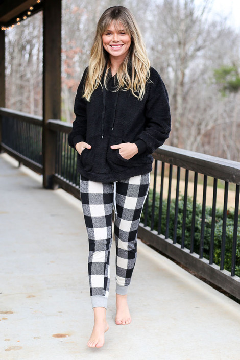 Dress Up model wearing the Buffalo Plaid Joggers with a black fuzzy knit hoodie