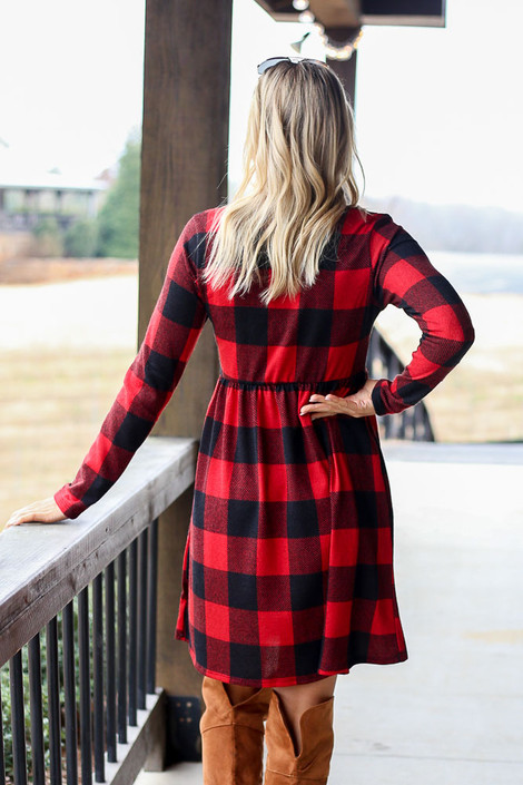 Model wearing the Buffalo Plaid Babydoll Dress in Red from Dress Up with over the knee boots Back View