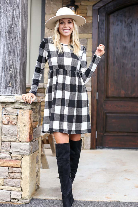 Model wearing the Buffalo Plaid Babydoll Dress from Dress Up with over the knee boots Front View