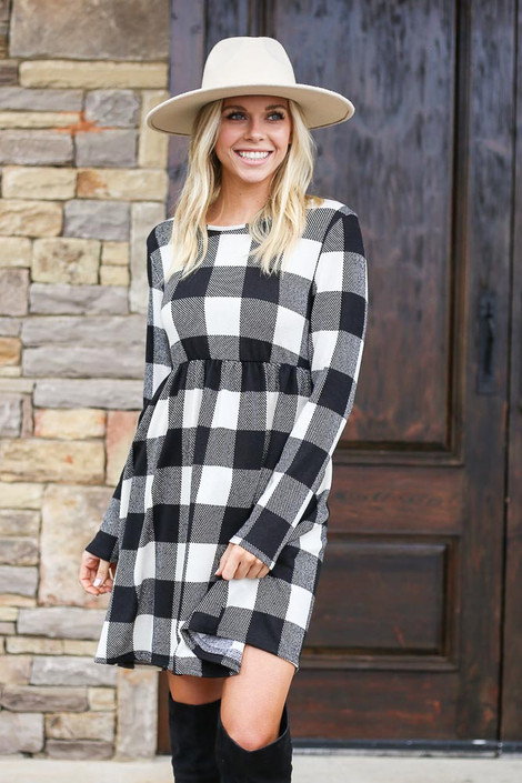 Model wearing the Buffalo Plaid Babydoll Dress from Dress Up with wide brim hat Front View
