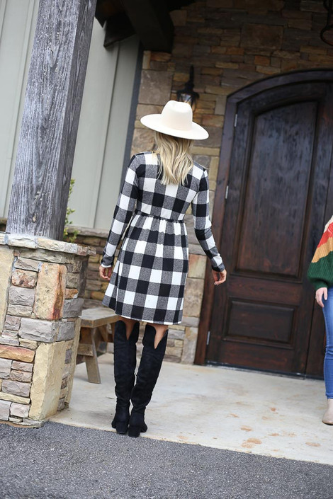 Model wearing the Buffalo Plaid Babydoll Dress from Dress Up with over the knee boots Back View
