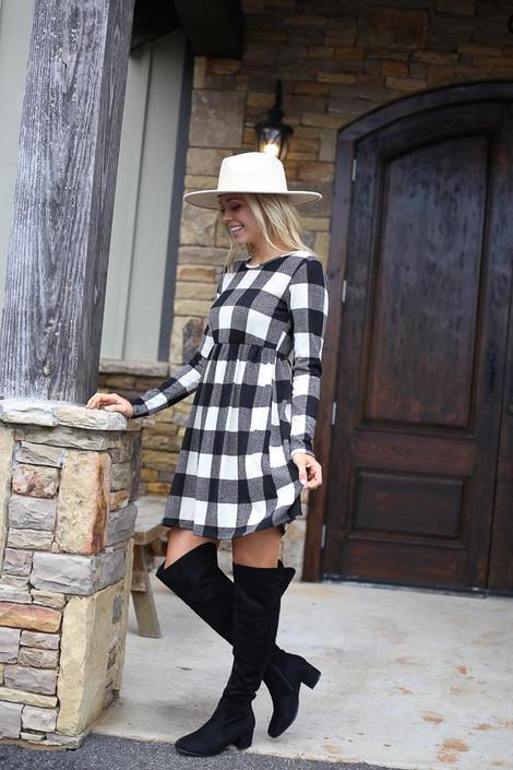Model wearing the Buffalo Plaid Babydoll Dress from Dress Up with over the knee boots Side View