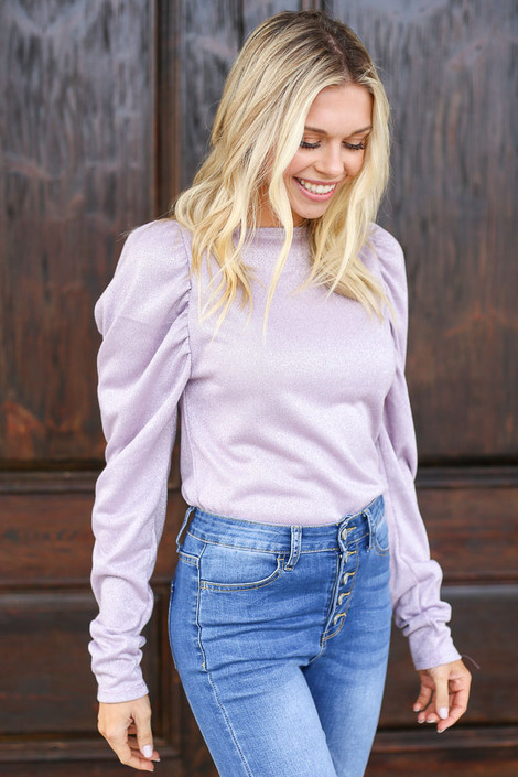 Model wearing the Lilac Glitter Knit Top with high rise jeans Front View