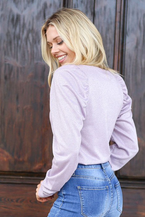Model wearing the Lilac Glitter Knit Top with light wash jeans Back View