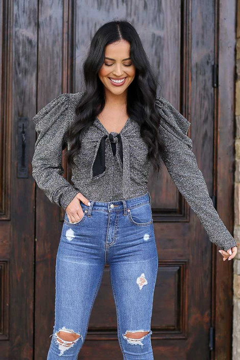 Model wearing the Black Tie-Front Glitter Knit Top with high rise jeans Full Outfit Front View