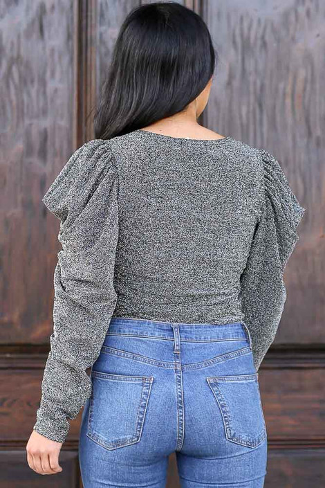 Model wearing the Black Tie-Front Glitter Knit Top with high rise jeans Back View