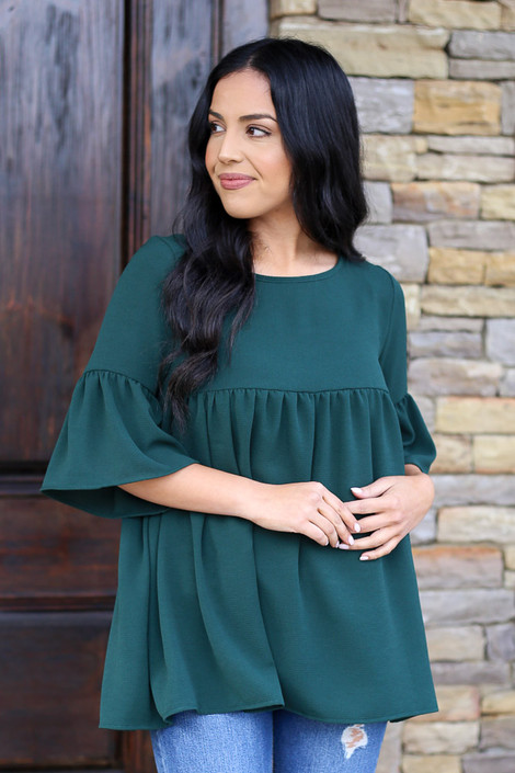Dress Up model wearing the Ruffle Sleeve Babydoll Blouse in Green